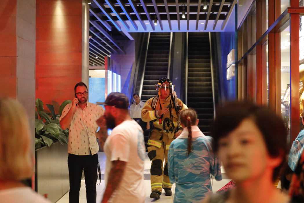 In this Monday, Aug. 5, 2019, photo, a firefighter walks out of the Waikiki Beachcomber by Outr ...