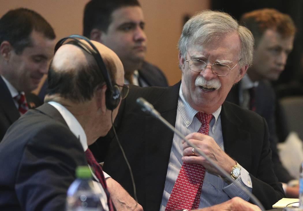 U.S. National security adviser John Bolton, right, speaks with U.S. Commerce Secretary Wilbur R ...