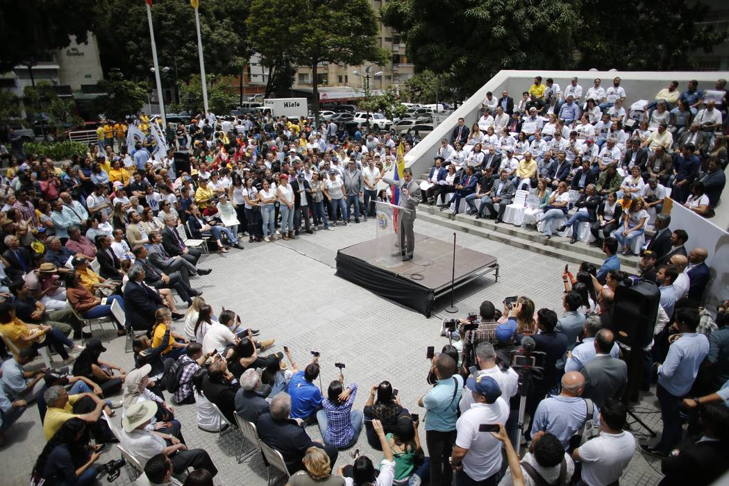 Opposition leader and self-proclaimed interim president of Venezuela Juan Guaido speaks during ...