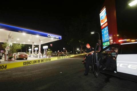 Garden Grove police stand watch at the scene of a stabbing in Garden Grove, Calif., Wednesday, ...
