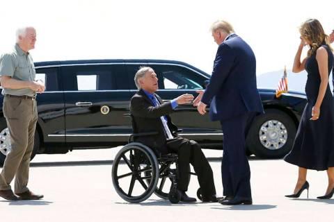 President Donald Trump and Melania Trump greet Texas Gov. Greg Abbott after arriving in El Paso ...