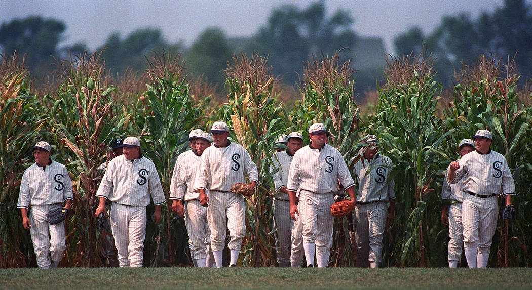 In this July 22, 1977, file photo, people portraying ghost players emerge from a cornfield as t ...