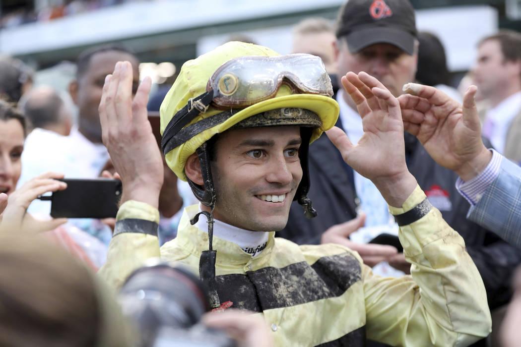 Jockey Flavien Prat reacts learning he won the 145th running of the Kentucky Derby horse race w ...