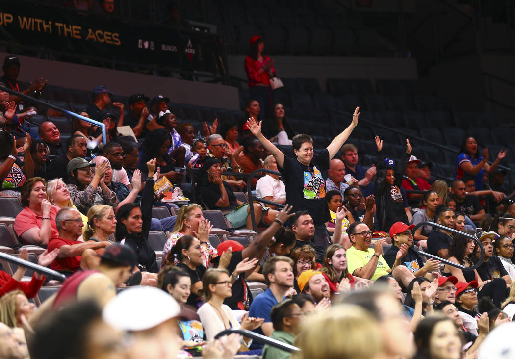 Las Vegas Aces fans cheer during the first half of a WNBA basketball game against the Washingto ...