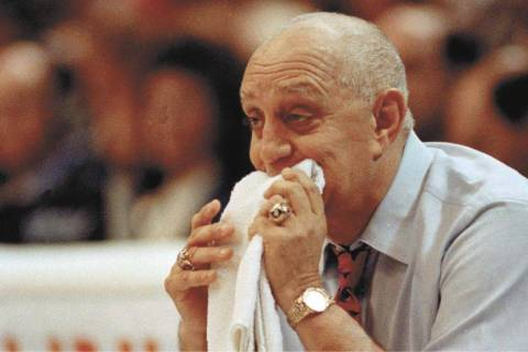 In this April 2, 1990, file photo, UNLV coach Jerry Tarkanian chews on his towel while watching ...
