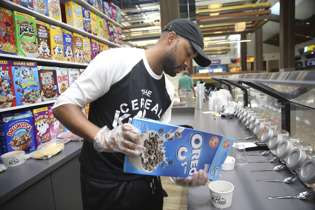 Chris Burns, owner The Cereal Killerz Kitchen, fills an order at his restaurant inside the Gall ...