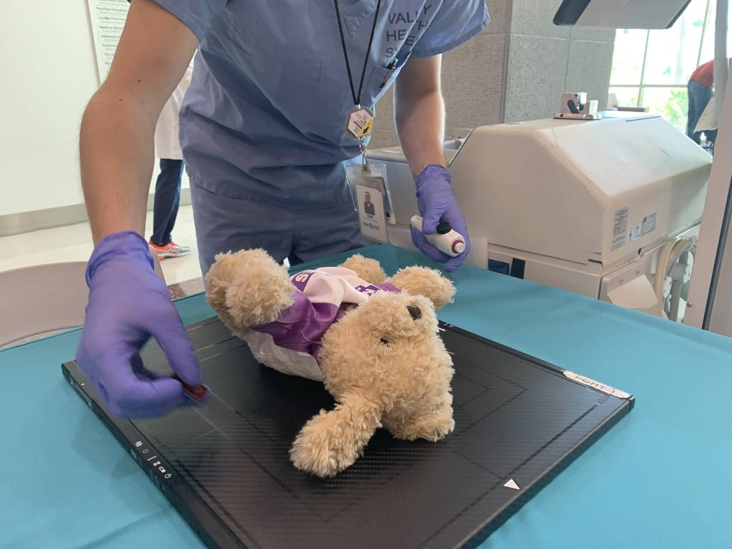 Hospital staff performed X-Rays, breathing treatments and broken limb repairs to teddy bears on ...