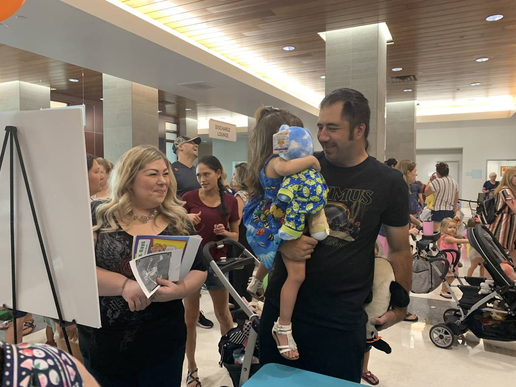 Jennifer Jacobs, left, attended the event with her 2-year-old daughter Jade and her husband. ( ...