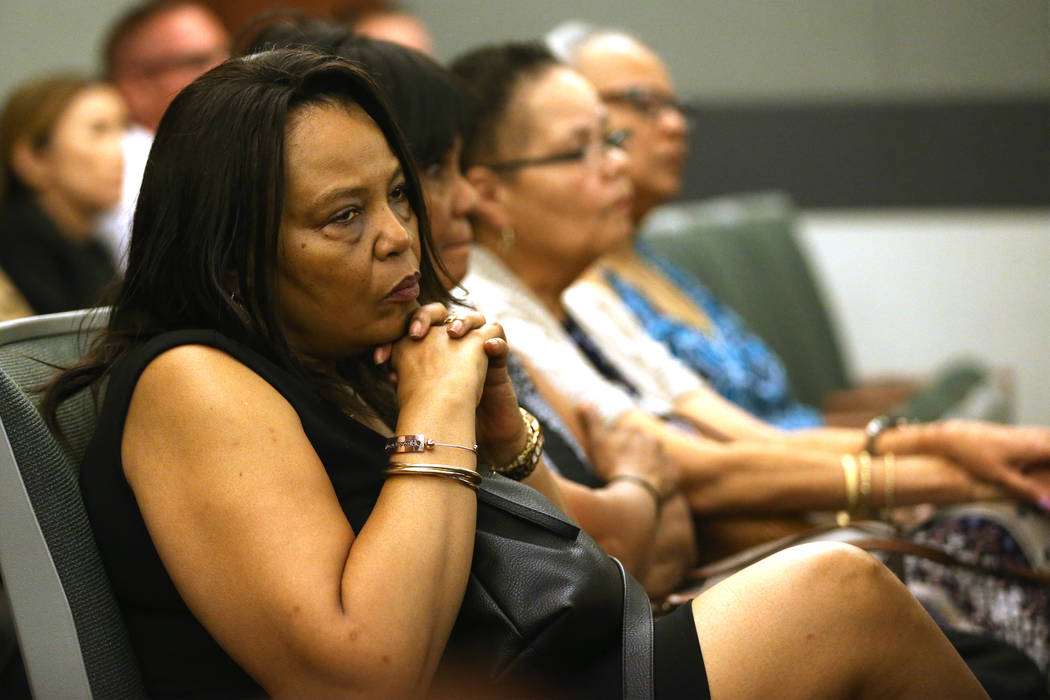 Rita Harris, left, listens to arguments for the case involving her cousin Paul Browning, who sa ...