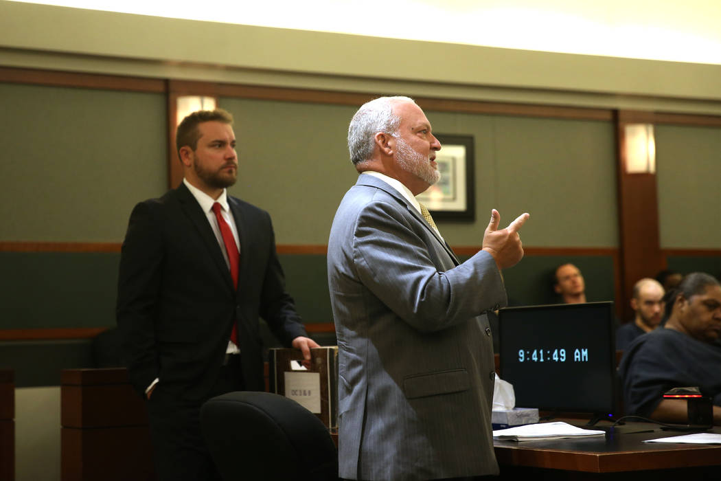 Chief Deputy District Attorney Marc Digiacomo, right, with prosecutor Jory Scarborough, gives h ...