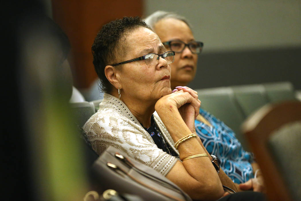 Dell Harris, with her cousin Kathy Clayton, listens to arguments for the case involving her bro ...