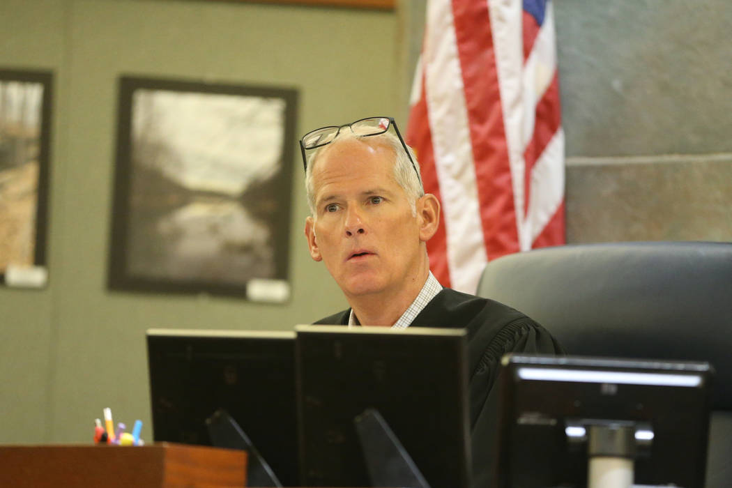 Judge Douglas W. Herndon listens to arguments for the case involving Paul Browning, who sat on ...