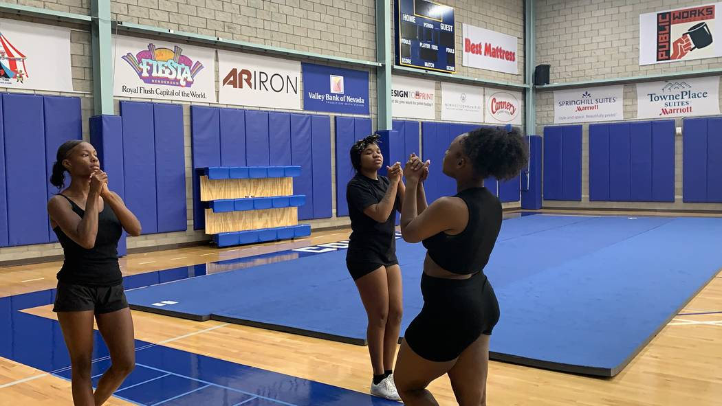 Jhailen Moorer-Johnson, right, teaches practices a cheer routine with her teammates during prac ...