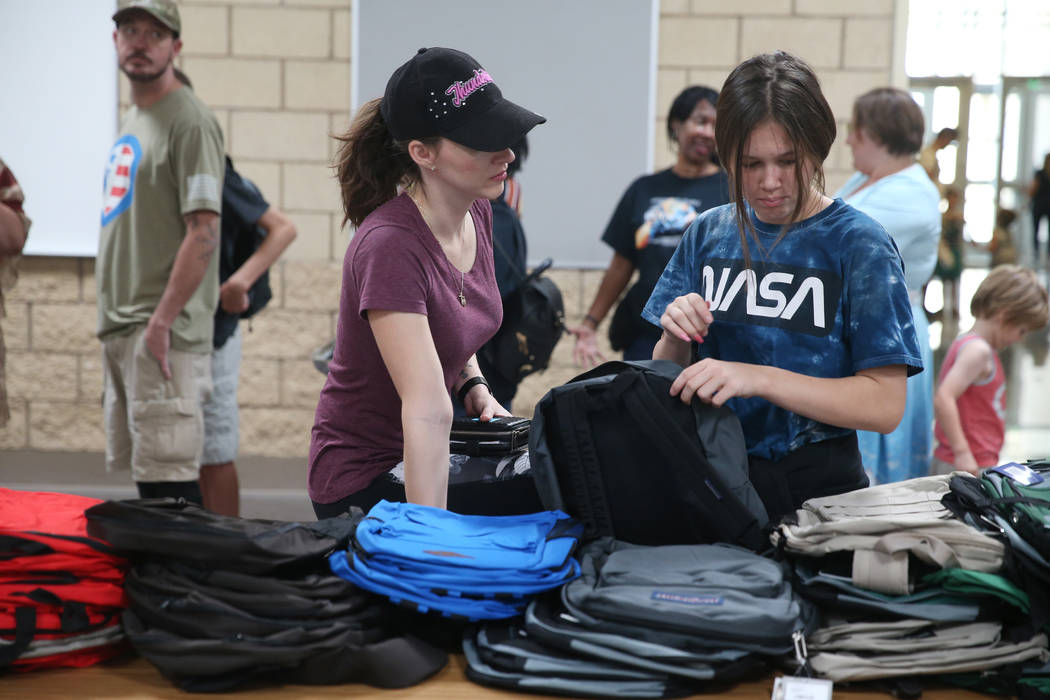 Taresa Olson, left, and her daughter Cambria, 12, select free school supplies during an event f ...