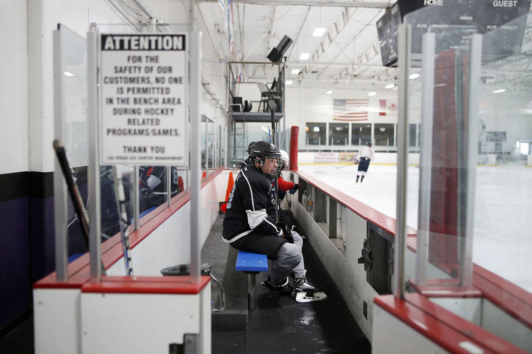 Joe Blau sits in the box during Ronnie's Hockey Club, a pickup ice hockey league at the Las Veg ...