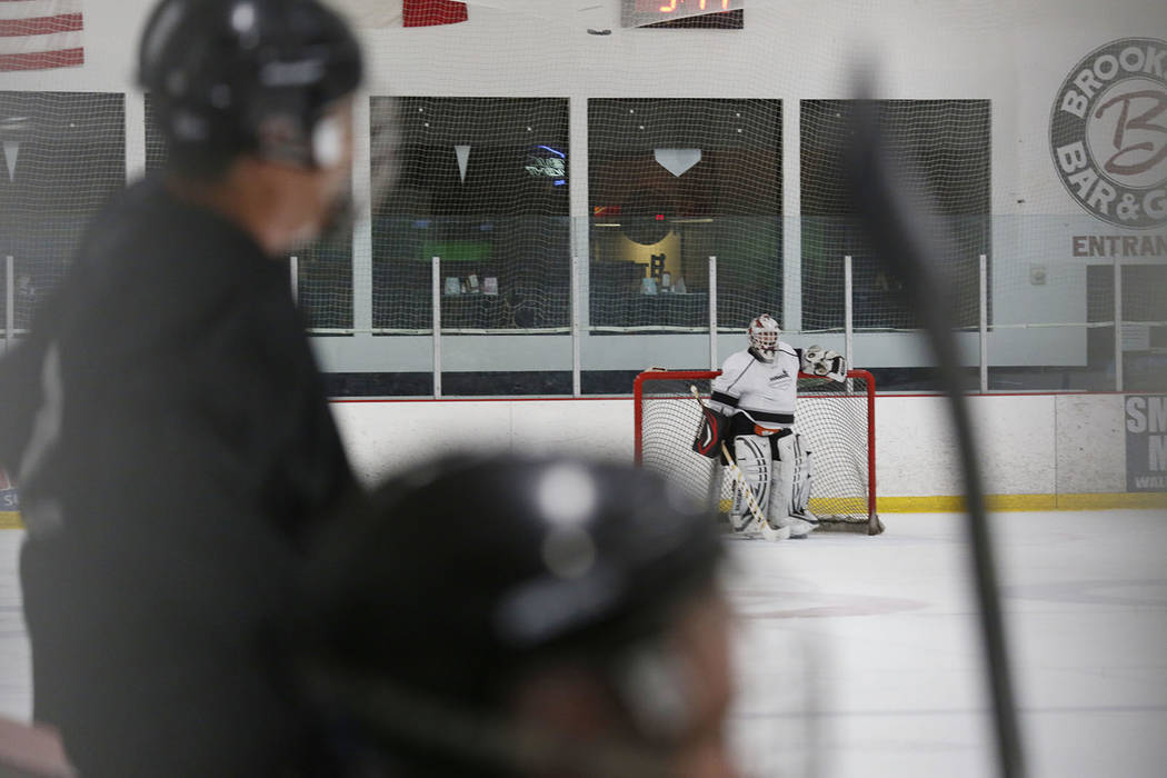 Goalie Dave Holm, 76, during Ronnie's Hockey Club, a pickup ice hockey league at the Las Vegas ...