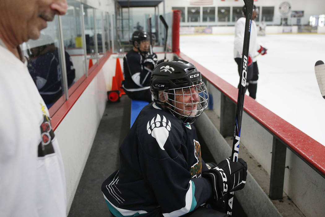 Player Chuck Gariepy waits to get onto the ice during Ronnie's Hockey Club, a pickup ice hockey ...