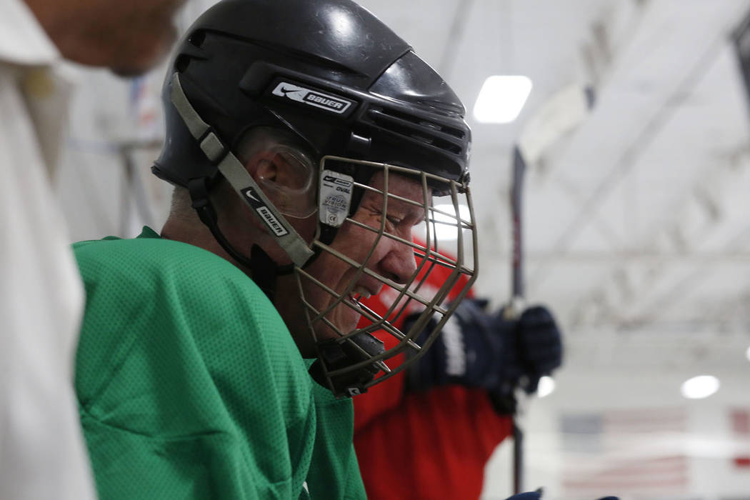 Player Sean McCrossan waits to go back onto the ice during Ronnie's Hockey Club, a pickup ice ...