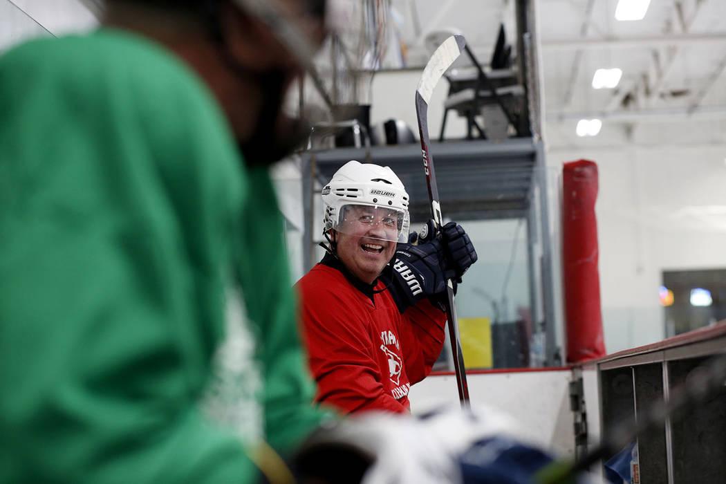 Player Sean Glenn Burgess waits to go back onto the ice during Ronnie's Hockey Club, a pickup ...