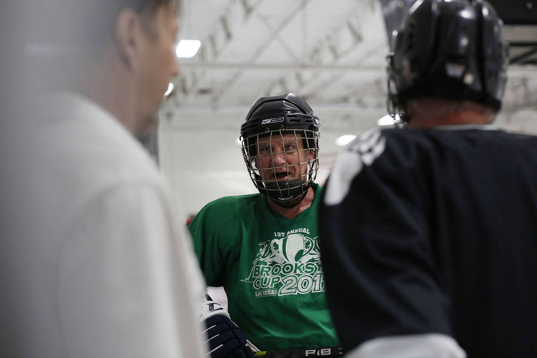 Player Sean McCrossan comes off of the ice during Ronnie's Hockey Club, a pickup ice hockey lea ...
