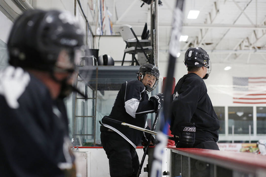 Player Arthur Wong, centers gets onto the ice during Ronnie's Hockey Club, a pickup ice hockey ...