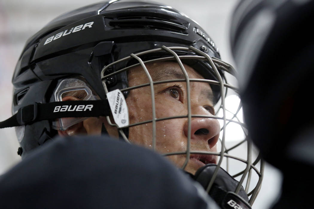 Player Arthur Wong comes off of the ice during Ronnie's Hockey Club, a pickup ice hockey league ...