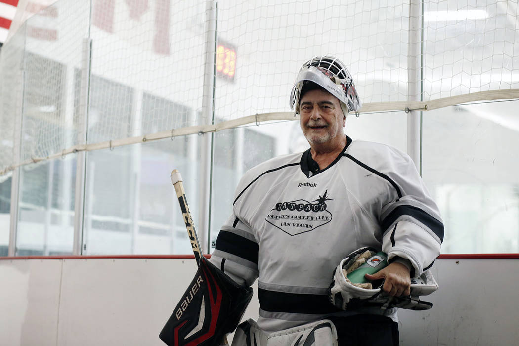 Goalie Dave Holm, 76, finishes a game during Ronnie's Hockey Club, a pickup ice hockey league a ...