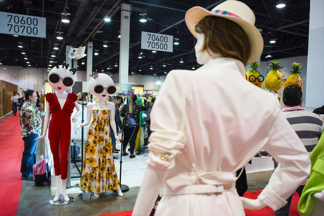 A view of colorfully clothed mannequins at the INA booth during the Sourcing at MAGIC trade sho ...