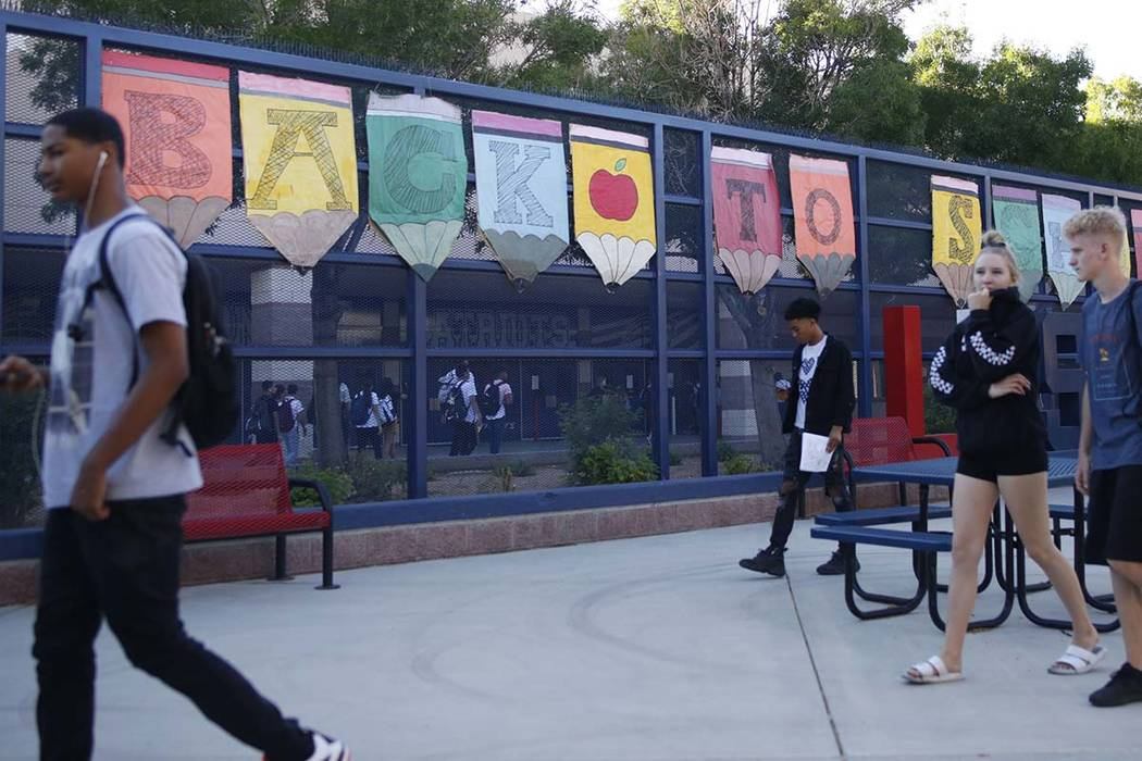 Students head to class on the first day of school at Liberty High School in Henderson, Monday, ...