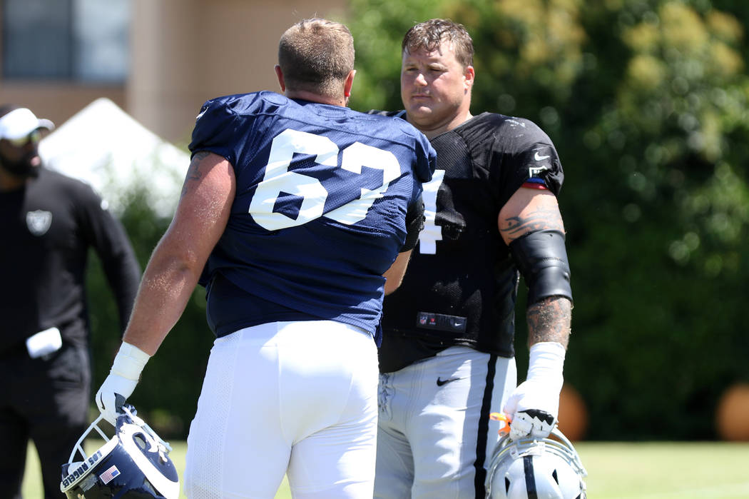 Los Angeles Rams center Vitas Hrynkiewicz (63) meets with Oakland Raiders offensive guard Richi ...