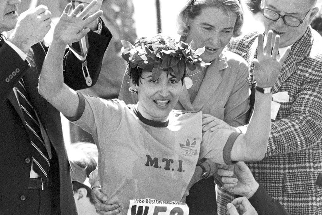 FILE - In this April 21, 1980 file photo, Rosie Ruiz waves to the crowd after after being annou ...