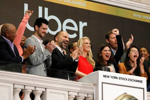 In a May 10, 2019, file photo Uber CEO Dara Khosrowshahi, third from left, attends the opening ...