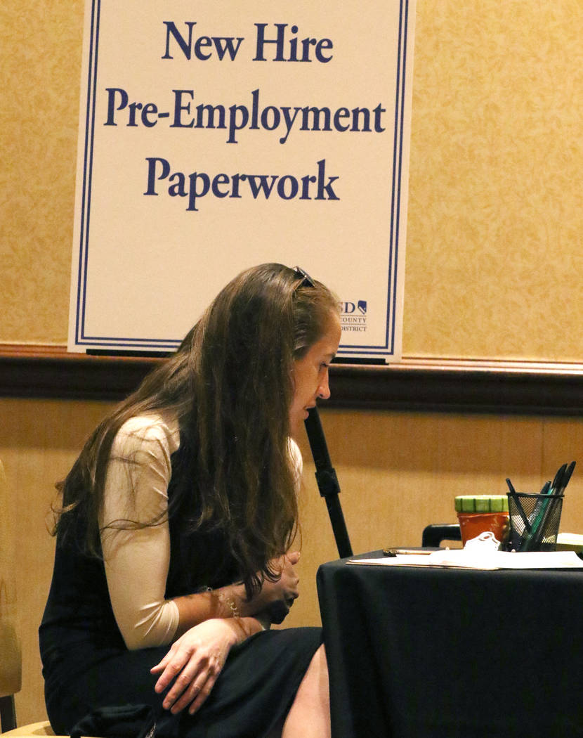 Ashley Robins, reviews documents during the Clark County School District new teacher hiring eve ...