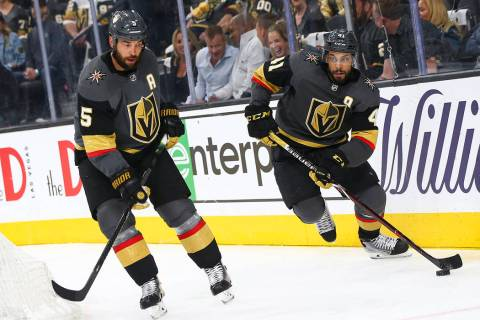 Golden Knights center Pierre-Edouard Bellemare (41) skates with the puck alongside defenseman D ...