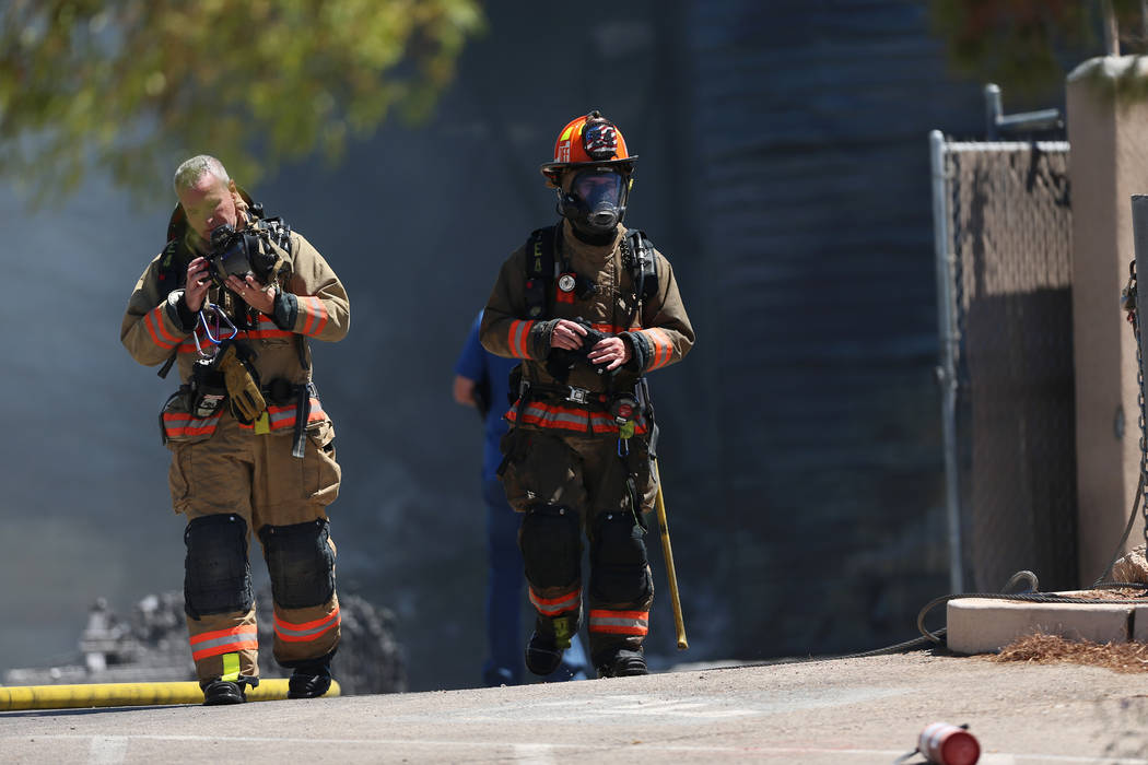 Firefighter leave the scene of a structural fire near the intersection of Losee Road and West L ...