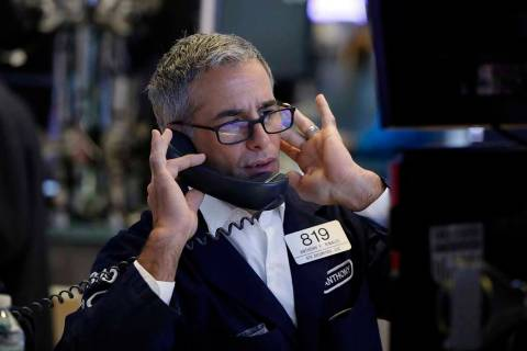 Specialist Anthony Rinaldi works on the floor of the New York Stock Exchange, Friday, Aug. 9, 2 ...
