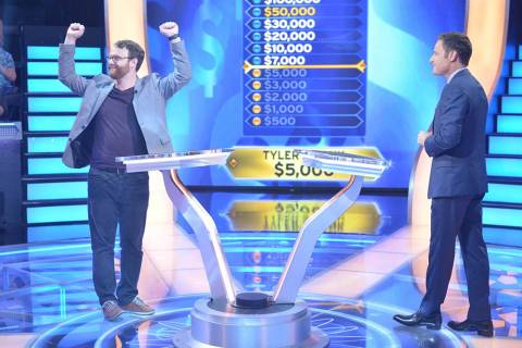 """Who Wants To Be A Millionaire"" contestant Tyler Crosby celebrates as he answers the $5,000 que ..."