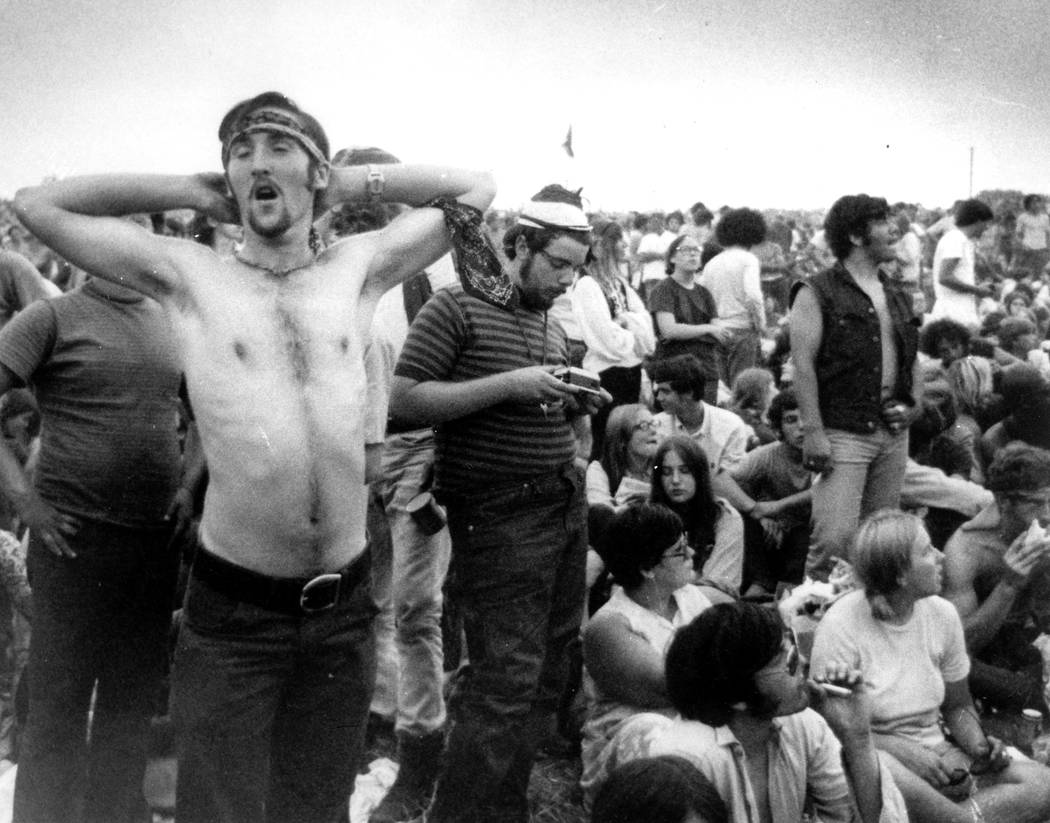 In this Aug. 16, 1969 file photo rock music fans relax during a break in the entertainment at t ...