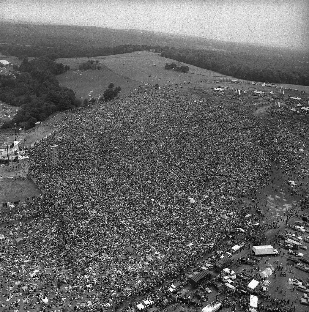 About 400,000 people attend the Woodstock Music and Arts Festival in Bethel, N.Y., August 16, 1 ...