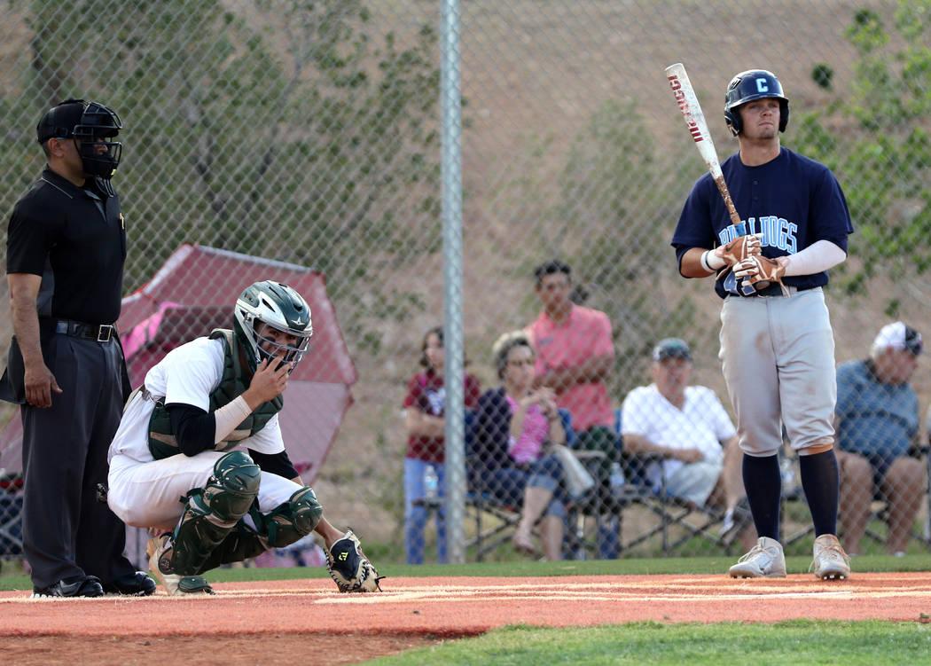 Centennial High School outfielder Austin Kryszczuk, right, prepares to bat as Palo Verde catche ...