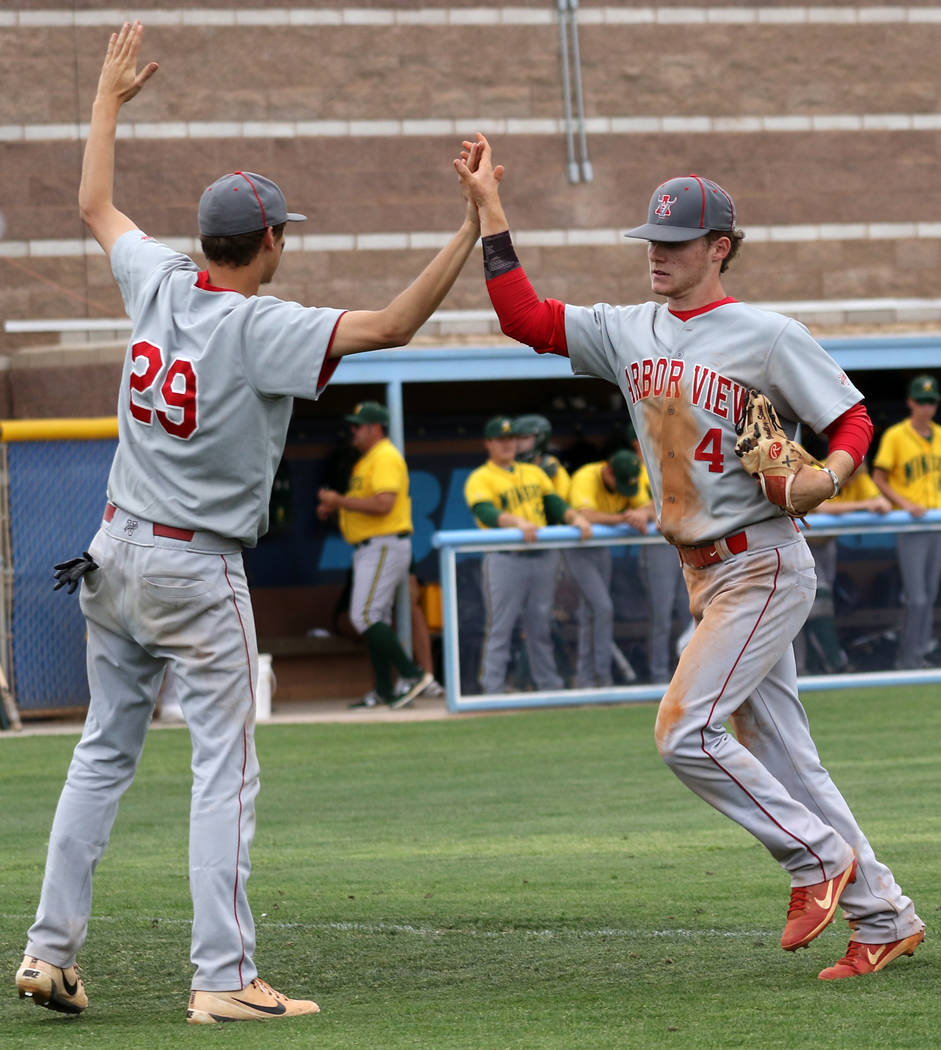 Arbor View baseball players Brennan Holligan, left, and Brad Stone, who were teammates on the M ...