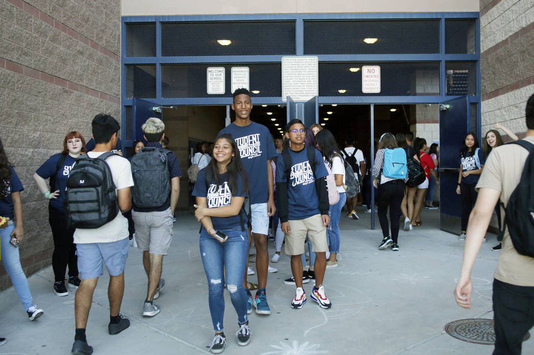 Student council members welcome fellow students on the first day of school at Liberty High Scho ...