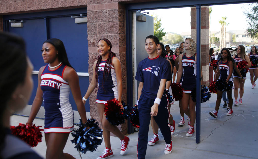 The spirit squad arrives on the first day of school at Liberty High School in Henderson Monday, ...