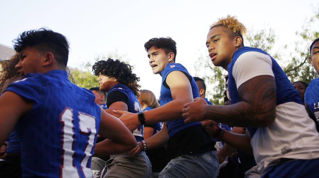 Members of the Liberty High School football team preforms a ceremonial Haka for the first day o ...