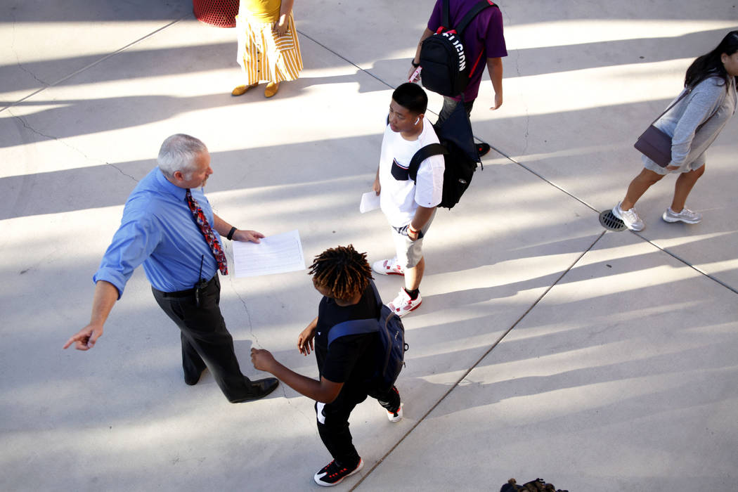 Students get directed to their homerooms on the first day of school at Liberty High School in H ...