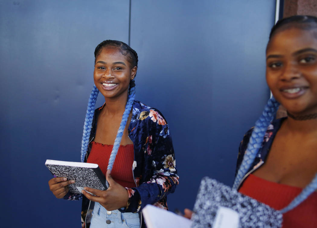 Sophomores Tashira, left, and Dashira McKay, 15, arrive on the first day of school at Liberty H ...