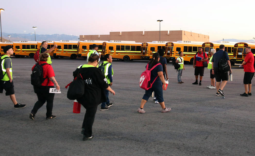 Clark County School District bus drivers arrive at the Wallace Transportation Yard in Henderson ...