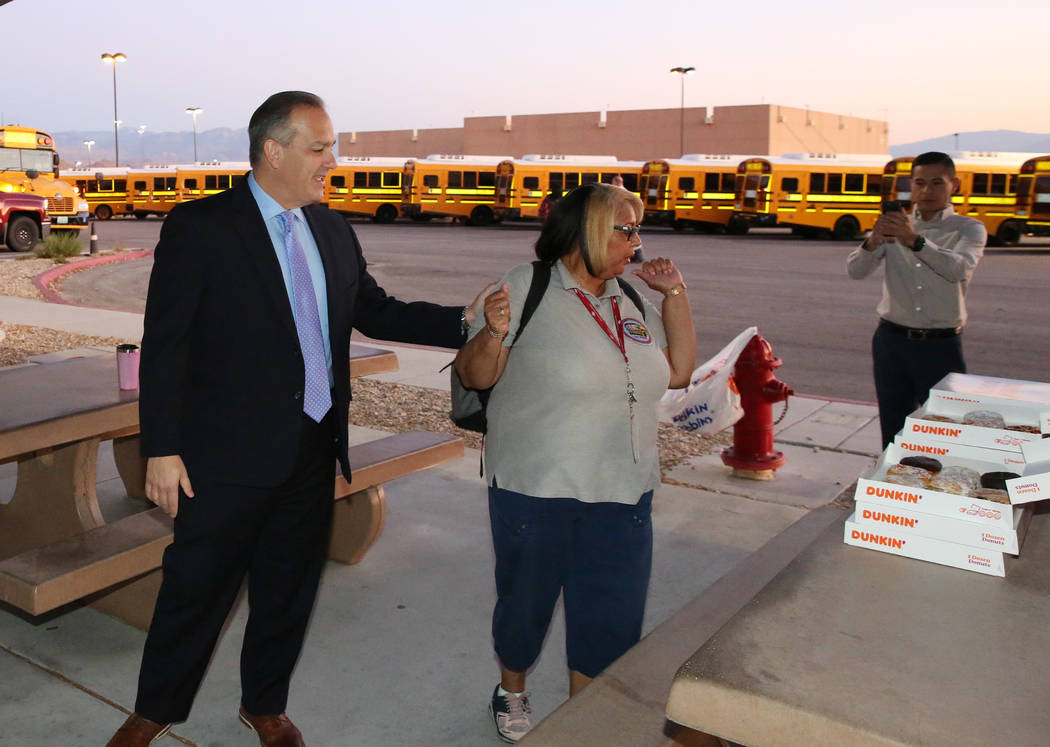 Clark County School District Superintendent Dr. Jesus F. Jara, left, offers donuts to CCSD bus ...