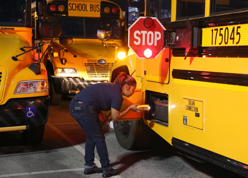 Clark County School District bus driver Alexis Quon inspects her bus at the Wallace Transportat ...