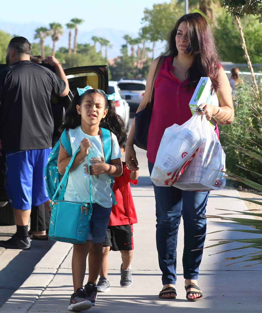 Natalia Rodriguez, 5, accompanied by her mother, Deborah, and her brother, Angel, arrives at Ro ...